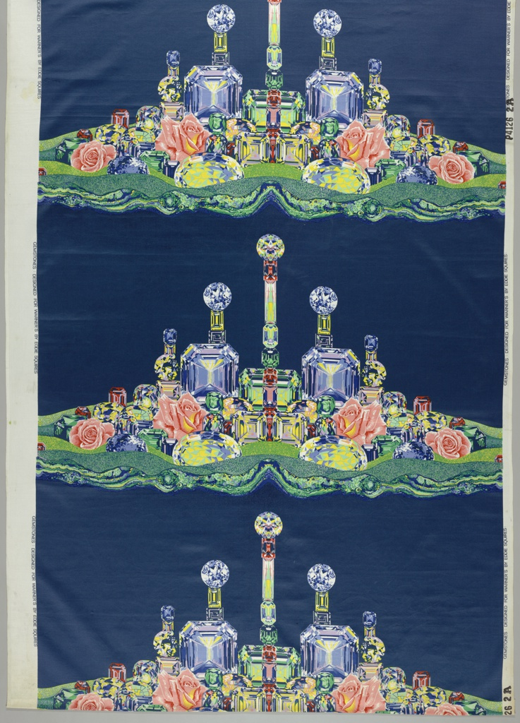 Landscape of brightly colored cut gems and roses on a deep blue background.2 reds, yellow, lavendar, 2 greens, 3 blues.