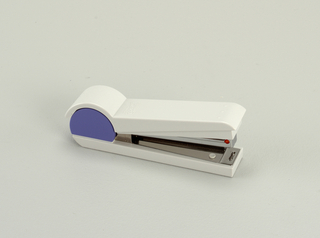 Small stapler. Body components of white and purple plastic.