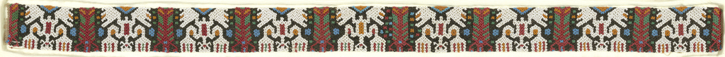 A band with a repeating pattern of a person with large hands and feet in white beads. People alternate with figure (lobster?) in red and dots in light blue beads. Ground alo features bead of black, green, and tan.