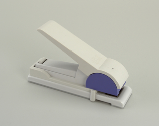 Large stapler. Body components of white and purple plastic.
