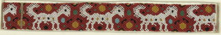 A continuous band with a repeating pattern of a four legged animal. The animal is white on a red ground. Ground also features pattern of dots in light blue, tan, dark green, and black.