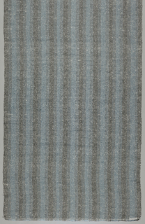 Warp: blue and black Rovana. Weft: black Rovana and white asbestos.