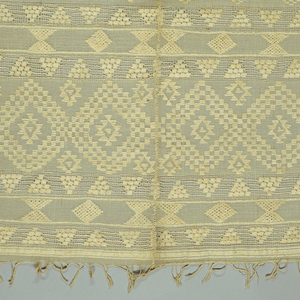 Two lengths of sheer cotton seamed down longest edge. Spaced bands of lozenges and triangles inlaid with heavier cotton thread. Deep borders edged with openwork bands at either end. Twisted warp fringe.
