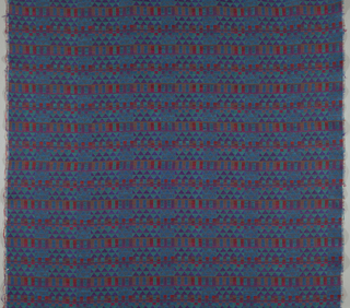 Panel of heavy textured rayon. Against a bright blue-green ground are small-scale patterns made up of triangles, squares and rectangles in shades of red and purple.