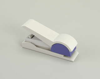 Medium-sized stapler. Body components of white and purple plastic.