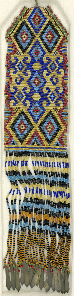 A rectangular panel in red, yellow, dark blue, light blue, orange, green, and black beads with a bottom fringe of beads and brass dangles.