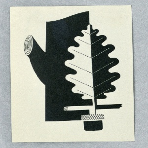 Photograph of a design for a motif, possibly for an advertisement poster depicting a tree trunk with truncated limbs and a disproportionately large oak leaf superimposed over the trunk at left. The leaf (half black and half white) emerges from an abstracted depiction of an acorn, below.