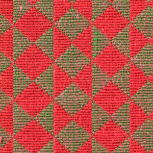 Double cloth in a red and brown striped pattern of diamonds and triangles. Red warps and red wefts intersect to appear as solid areas of color while the green and pink warps and wefts intersect and appear as brown in color.