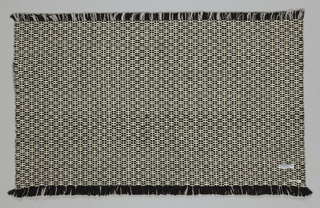 Panel of black and white handwoven wool combined with synthetic and weft novelty yarn