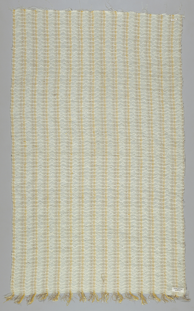 Long panel of casement fabric in stripes of gold, yellow, white and natural color.