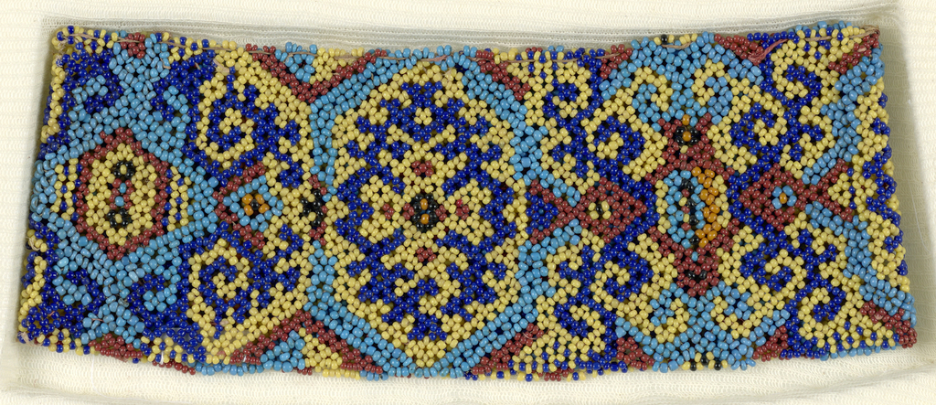 A continuous band with a geometric pattern in brown, orange, and two shades of blue beadwork.