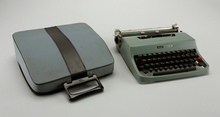 "A green/grey metal cased typewriter with a white keypad and black keys. ""olivetti"" and ""lettera 32"" in black and white on front of typewriter."