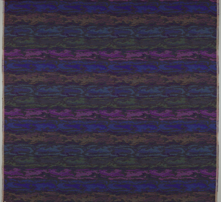 Heavy handwoven panel with a textured horizontal striae in blue, shades of purple, magenta, and dark red.