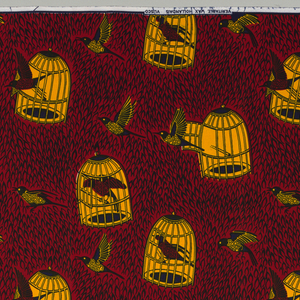 Birds, in and out of open cages, on a feather-textured background. Printed in indigo, yellow and red on a white ground.