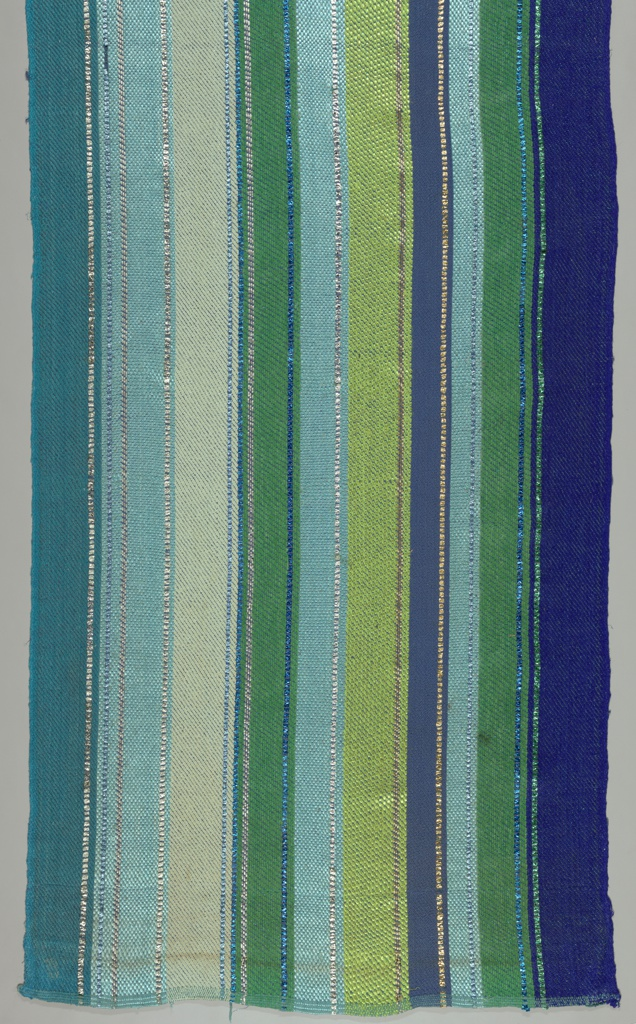 Warp stripes of shades of blue and green with narrow accents of metallic.