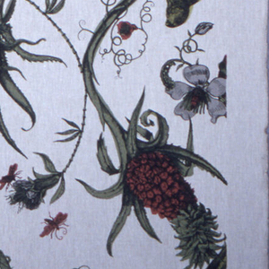 Length of printed linen with a large scale design of an iguana caught in the tendrils of a fantastical plant that is both an aloe and a pineapple, with parrots, moths, bugs and blossoms. Printed in red, green and black on a white ground.