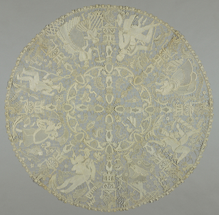 Circular table cover with various male and female figures in the border.