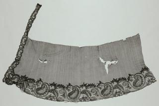 """Black lace showing a Lille-patterned border and """"point de Paris"""" net."""