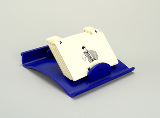 Blue, rectangular, curved tray holding tabbed, white divider cards.