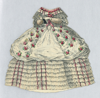 White dress lined with red roses at the neckline and roses on the upper portion of her dress.  White lace sleeves, and many small layers of white ruffle also adorn the dress.  Both back and front of dress depicted.