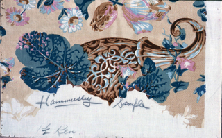 Reproduction-style fabric with a design of oversized flower motifs in blues, pinks and browns on a light tan ground.
