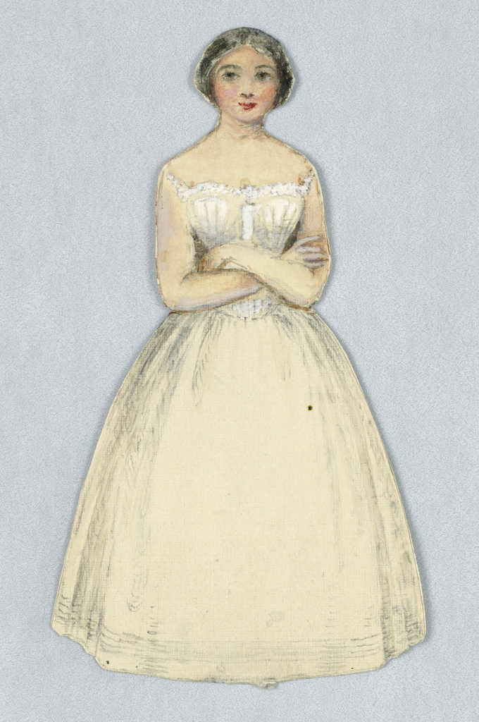 Black haired paper doll in white petticoats and camisole (corset?) with arms folded in front of her.