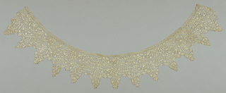 Lace collar of insertion and deep points in design of scrolling stems with flowers and leaves, birds, lions and dogs. Narrow band of bobbin lace at top.