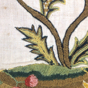 Linen embroidered in polychrome wool, in branch leaf and flower design. Linen warp and weft.