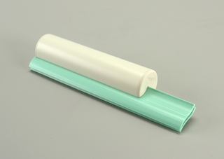 White cylindrical handle onpair of overlapping light green contoured squeegee blades.