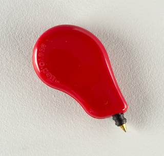 Ballpoint pen in red kidney-shaped plastic housing.