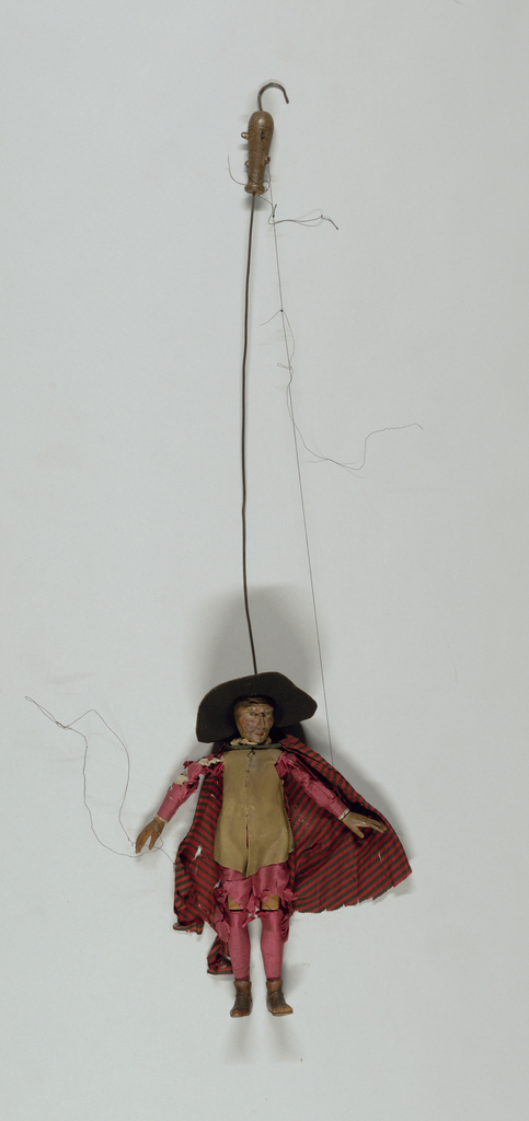 Set of Commedia dell'arte marionettes, each with facial masks and costume of stock character. 