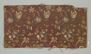 Undulating stems with flowers and fruit in polychrome silks and gold on a rust satin ground. The gold threads are gilded strips of paper cut to fit the desired pattern; not a true brocading technique.