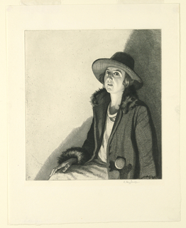 A woman in a broad-brimmed hat and wearing a coat with fur trim is seated, shown from her lap up.Her body faces left, with her head turned to face the viewer. Dramatic lighting, with the right of the composition in shadow.