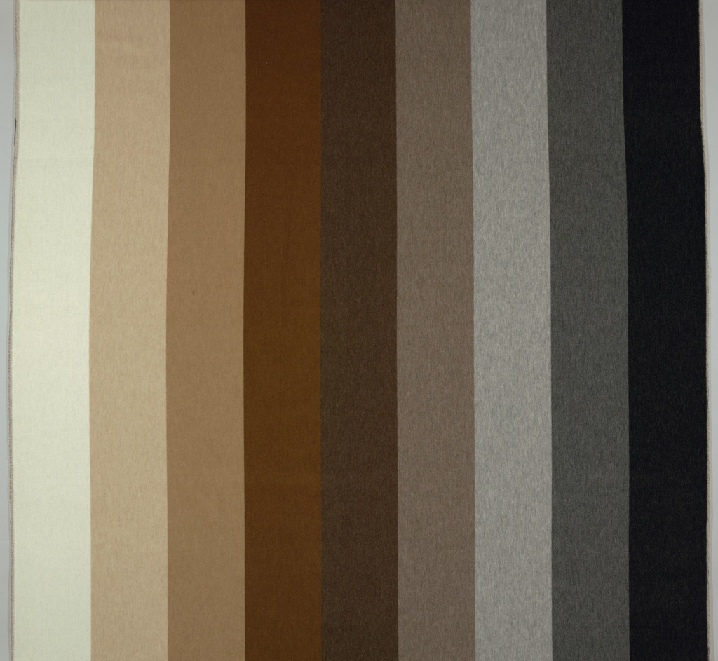 Sample blanket of vertical stripes of velvet woven in natural, undyed alpaca wool. Stripes are in nine different shades of black, gray, brown and off-white.