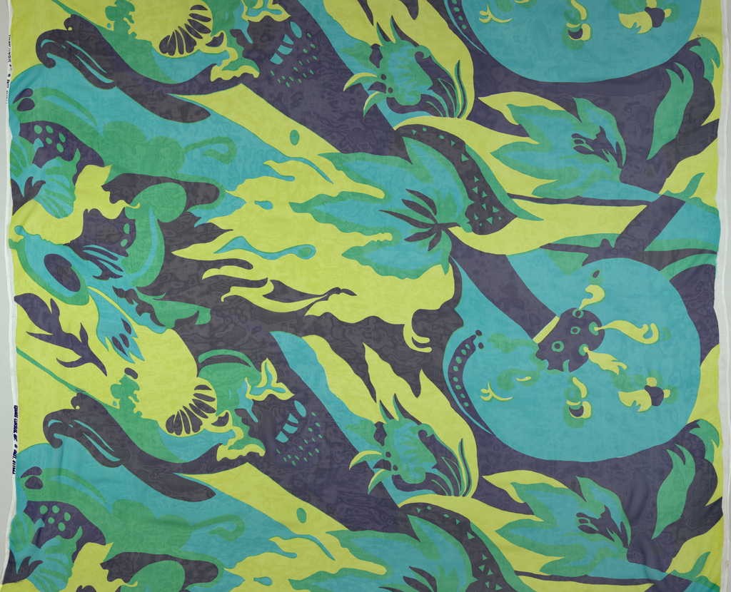 Design in shades of blue, green and yellow shows stylized flaming torch and bizarre floral elements in repeated pattern.