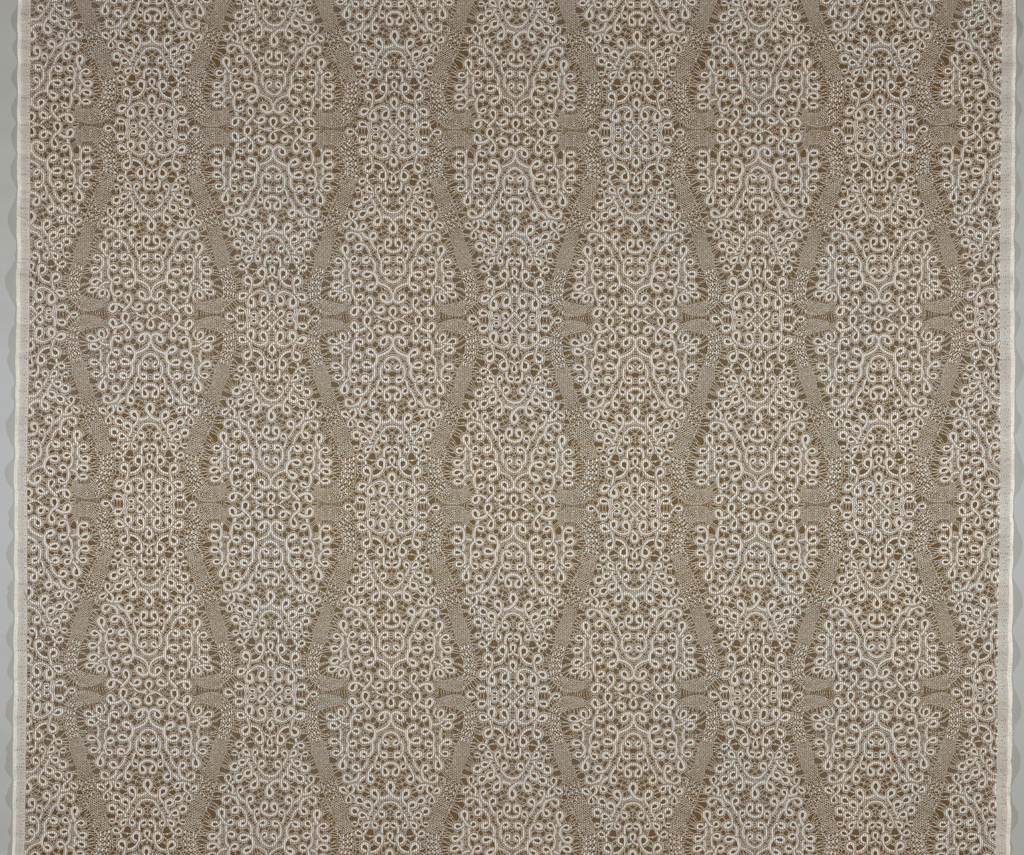 Dove brown ground with a pattern resembling white bobbin lace, with looping forms, bridges, net grounds, in an ogival framework.