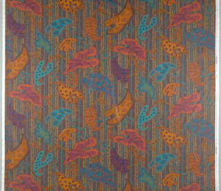 Large leaves in turquoise, orange and coral on a background of mottled grey and pink with green stripes.