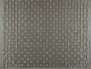 Double-sided fabric (silver-grey on one side, cream on the other) with a repeating three-dimensional image of a cube