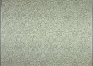 Panel of sheer white cloth acid printed to create large scale symmetrical design of Turkish inspiration. Acid printing is a process where the acid removes one of the fibers leaving a pattern on the foundation fabric which is acid resistant.