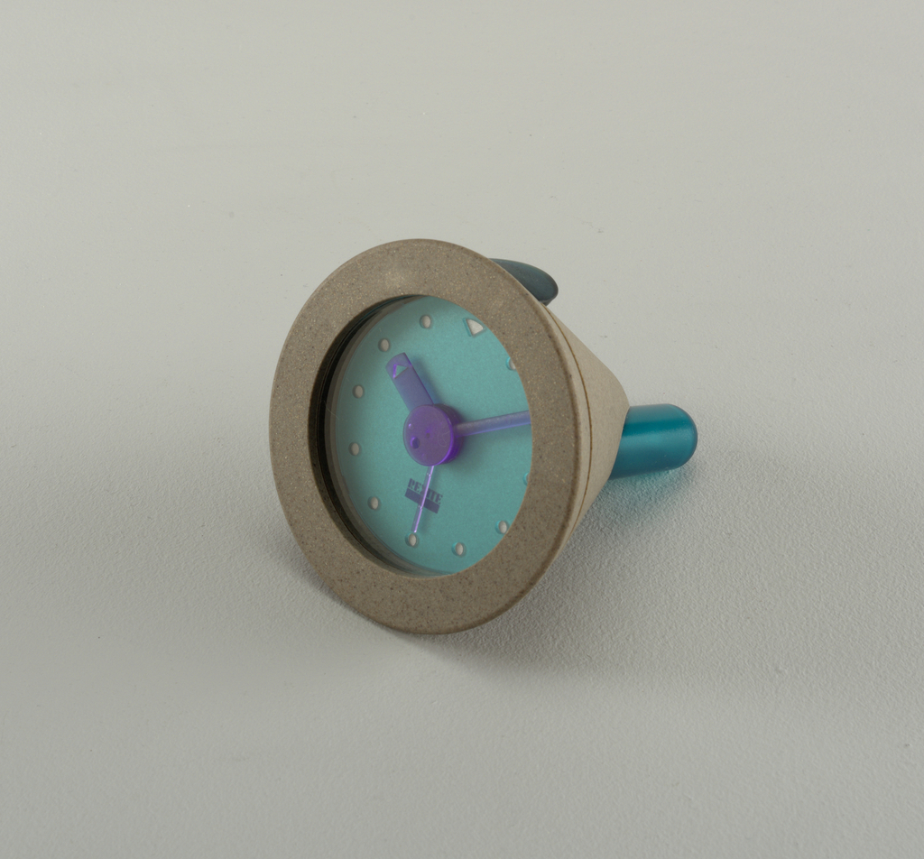 Grey table clock with alarm.