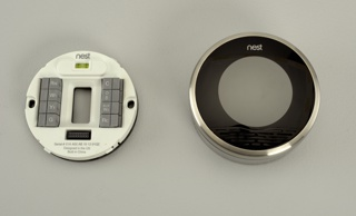 Large circular face, black when power is off, surrounded by circular, matte stainless steel housing.