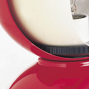 Red table lamp with red bell-shaped base and black bottom. Spherical top where light bulb sits opens to white shell.