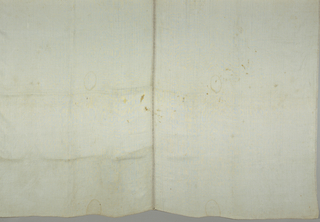 Two off-white panels with a piece of bobbin sewn between. Drawnwork details around the edges of the panels.