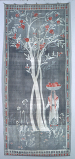 Oblong vertical hanging with a pomegranate tree in the center. A man carrying a basket of pomegranates on his head stands to the right of the tree. The borders are a repeat of pointed niche arches. In violet, light grey and red on an ivory ground. Lined with light rose cotton plain weave.