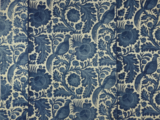 Hanging or large panel in two shades of indigo. Design shows a large-scale tree or vine with stylized pineapple, flowers, leaves and a large long-tailed bird.