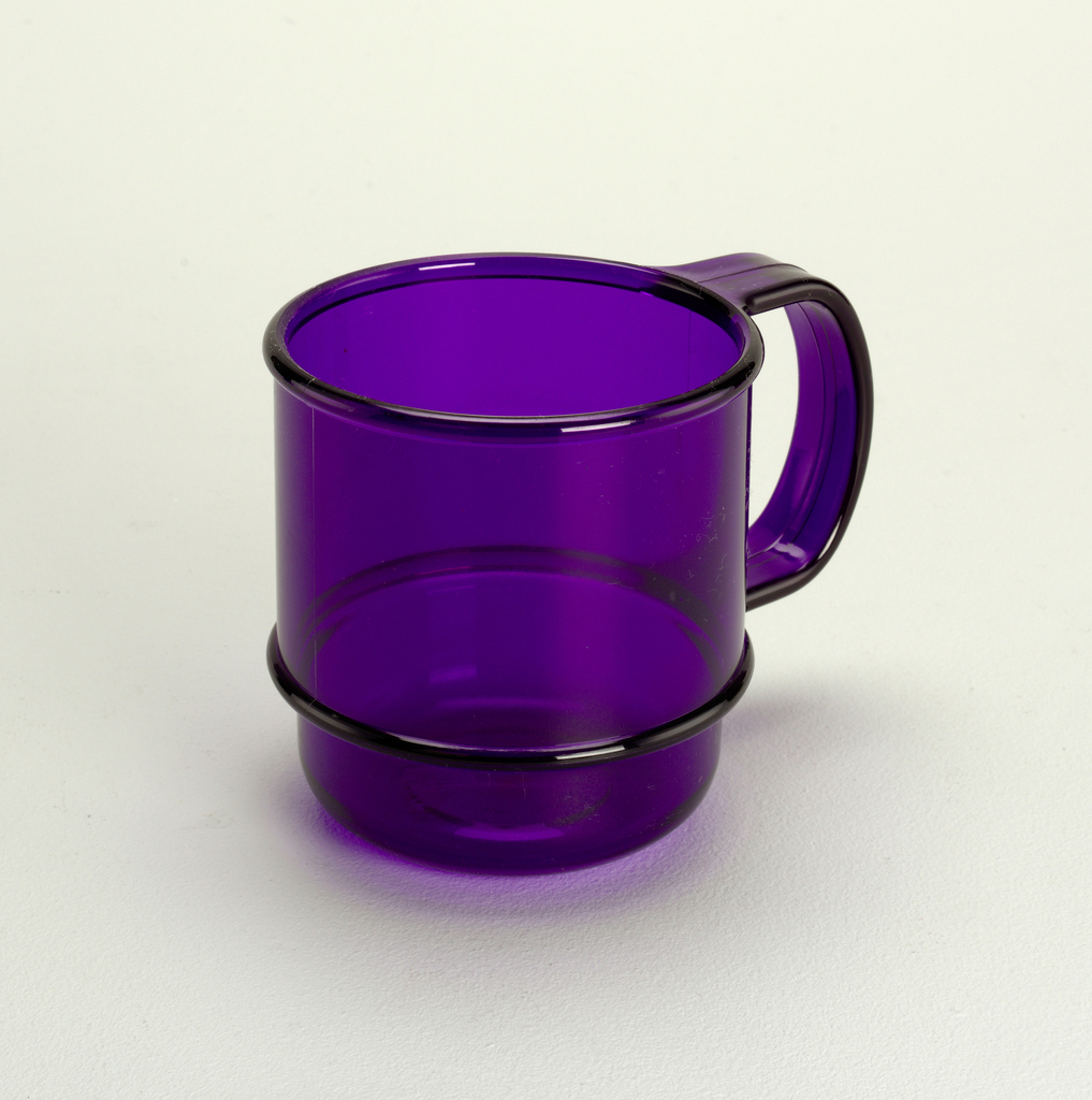 Transparent purple mug with molded horizontal bands and handle