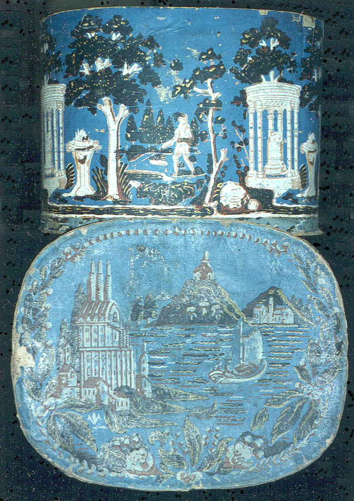 Blue field, with printing in brown, green, pink and white. Tempietto with setting of trees and one figure. Cover has castle on top of a mountain rising from a lake.