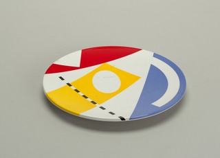 Blue, yellow, red, black on white background salad plate.