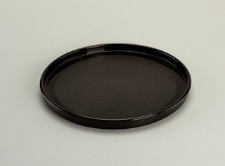 Flat, opaque black plate with lip