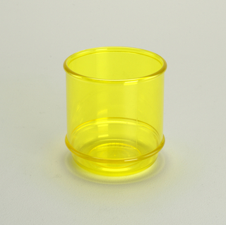Transparent yellow low tumbler with molded horizontal bands
